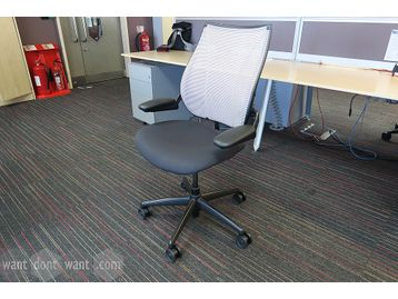 Used but only 1 year old Humanscale 'Liberty' chairs with grey mesh back and charcoal upholstered seat.