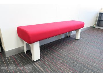 Used bench upholstered in red fabric with white legs