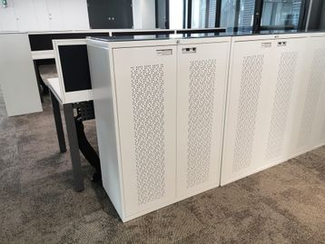 Maine double door cupboards with patterned perforated doors and tinted glass tops