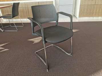 Torasen KS5A 'Kyos' chairs with black perforated back, black fabric seat and chrome cantilever frame