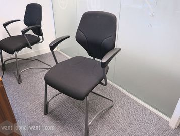 Used Giroflex visitor/meeting chairs upholstered in black fabric