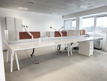 Used Vitra 6-person 'Joyn' desks with cable trays. Each user's desk space approx.1400mm wide