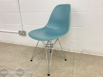 Genuine used Vitra DSR Plastic Side Chair with chrome Eiffel base. Designed by Charles/Ray Eames.