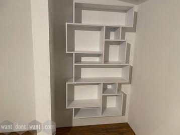 Used modern white shelving unit