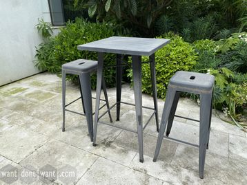 Used grey metal outdoor tables each with 4 x Tolix style metal stools.