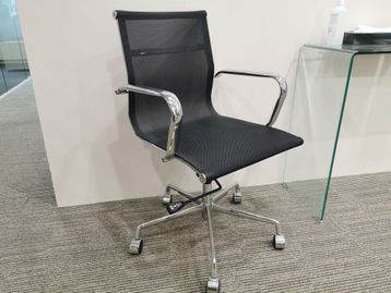 Eames style meeting chairs with black mesh seat and back.
