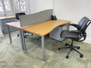Smart used double wave-shaped oak top desks with silver legs. 1600mm wide x 800mm deep.