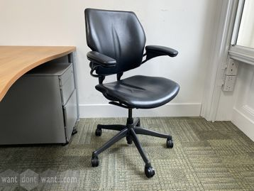 <b>296 x Used Humanscale 'Freedom' chairs in black hide.</b>