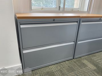 Used 'Bisley 2-drawer silver side filing units with oak MFC tops. 800mm wide.