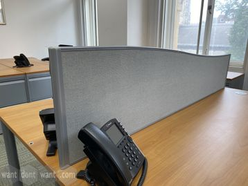 Used wave-shaped screens upholstered in grey flecked fabric.