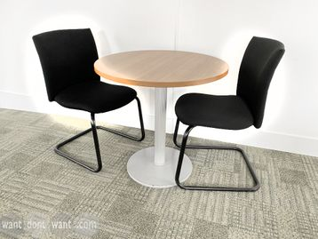 Used meeting table with oak top (750mm diameter) and silver column base.