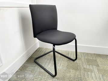Used comfortable 'Comforto' meeting chairs upholstered in black fabric with black cantilever frame.