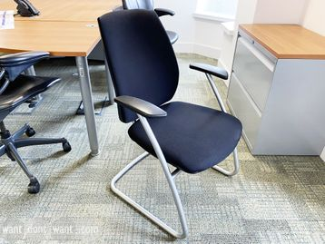 Used 'Task Systems' chairs upholstered in black fabric with silver cantilever frame.