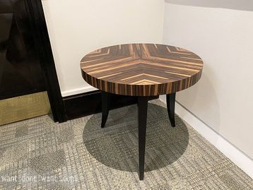 Used side table with zebrano veneer top and black splayed legs