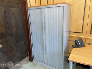 Used Bisley side tambour-door storage cupboard with wooden top and shelves 1680mm high.