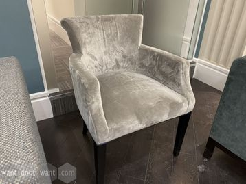 Used armchairs upholstered in silver suede-look fabric with dark wood legs