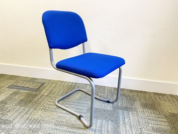Used side chairs upholstered in vivid blue fabric