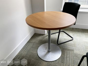 Used circular meeting table with oak top and silver column base.