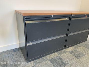 Used 'Bisley 2-drawer black metal side filing units with oak MFC tops.
