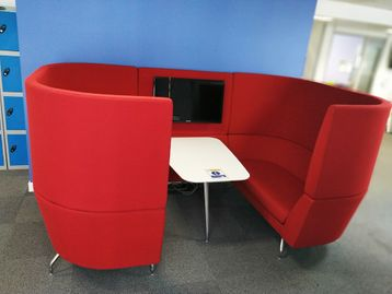 Used Orangebox 'Cwtch' high-back working sofa booths with attached centre table