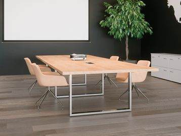 Modern 3800mm chrome design conference table equipped with connection ports and cable channelling.