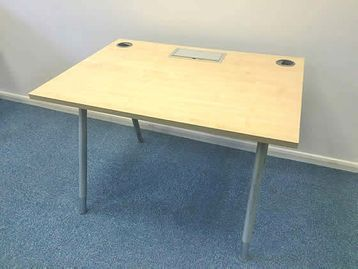 1100mm Maple desks with 2 x cable ports, 1 x lift up cable management lid and cable tray included.