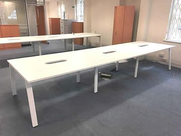 1000mm White bench desks with white 'A frame' legs, 1000mm x 800mm tops per position.