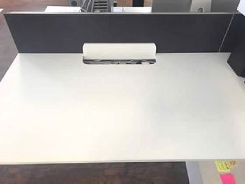 Further view of the 1400mm White Dynamobel TEC back to back bench desks shown in the previous image.