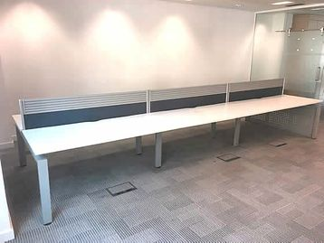 1600mm Senator Freeway Bench Desking with white tops, silver goalpost legs and desk dividing screens included.