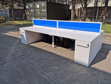 Used 1600mm 4-person Task 'Team' bench desks with White tops and Supporting Pedestals