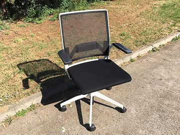 Dynamobel 'Dis' operator chairs with white frame and black fabric seat and mesh back.