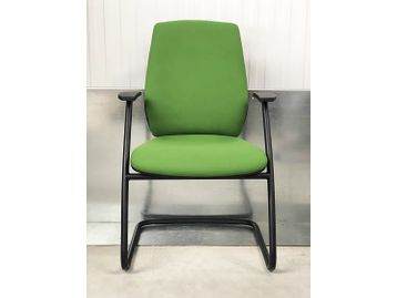 Brand New Contemporary Office Meeting Chairs fully upholstered in green fabric with a black cantilever frame and integral arm rests