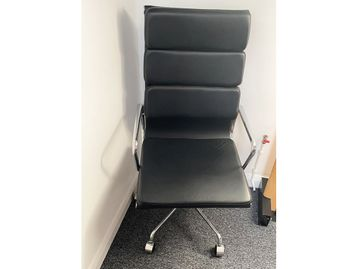 Used Eames-Style black leather faced swivel chairs with chrome arms and base