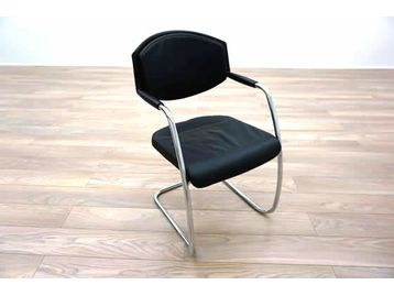 Giroflex 16 series black leather meeting chairs with chrome cantilever frame.