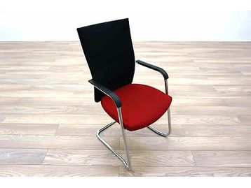 Connection Seating 'Flex' high back meeting chairs with red seat, black mesh back and chrome cantilever frame.