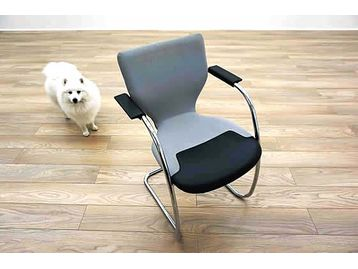 Orangebox X10 meeting chairs with grey fabric and black leather seat on a cantilever chrome frame.