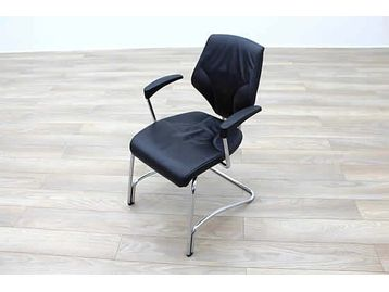 Giroflex 16 Series black leather cantilever meeting chairs.