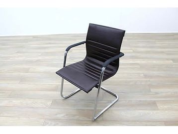 ICF cantilever meeting chairs with brown ribbed leather and chrome frame.
