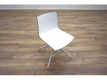 Arper Catifa '46' white meeting chairs with black edging.