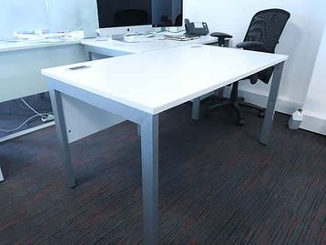 1400mm White desks with silver legs, modesty panel and cable ports included.