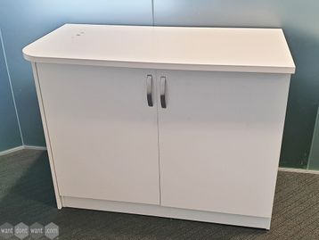 Used White Double Door Cupboards with Overhanging Tops
