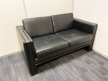 Used 2-seat sofa upholstered in high-grade black leather