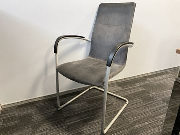 Used Kusch high back meeting chair in antiqued style grey leather upholstery.