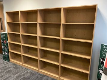 Used tall oak storage/bookcase with adjustable shelves