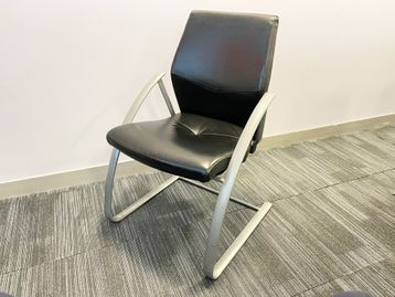 Used black leather meeting chairs manufactured by Verco