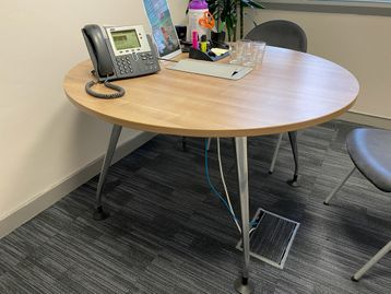 Used circular walnut mfc table with lift-up cable access door