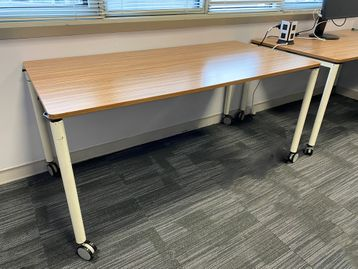 Used Konig and Neurath reconfigurable tables with walnut mfc tops and cream legs