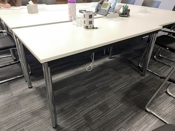 Used white tables with bright chrome tubular legs. These are from Team GB House 2012 Olympics