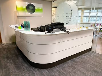 Used contemporary design reception desk with glass parcel shelf. 2840mm w x 2430mm d (max)