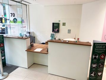 Used Reception Desk with white panels and walnut top.